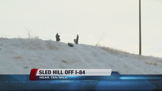 Sledding hill off I-84 grows in popularity