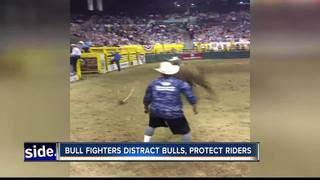 Bull fighting duo protects riders