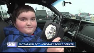 Nampa boy gets Christmas wish to be a cop
