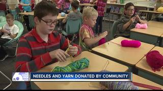 Fifth-graders knit scarves for the homeless