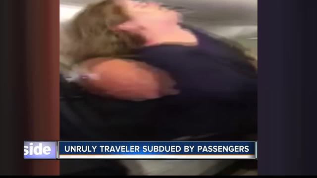 Woman restrained after trying to open airplane cabin door during flight