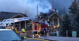 Crews battle fire at Warm Springs Lodge