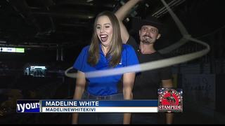 Man with fiery rope act performs at rodeo