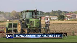 Iconic picture of a Caldwell farmer standing...