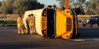 Bus driver cited in school bus/car crash